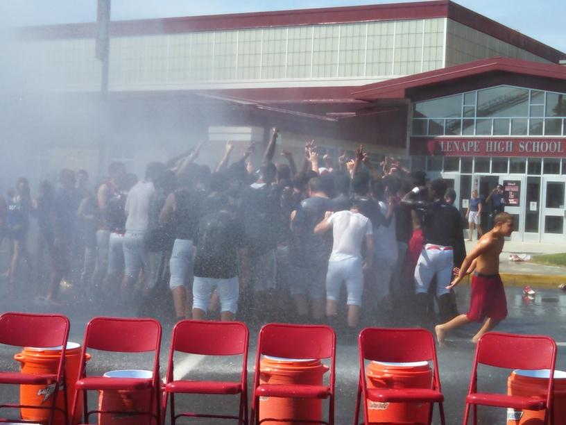 Mount Laurel Fire Department sprays the fall sports teams.