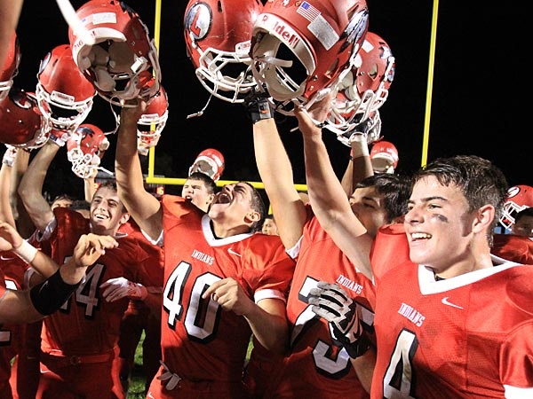 Lenape celebrates its 24-16 victory over rival Cherokee