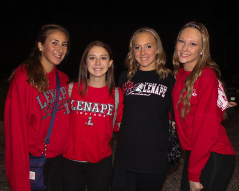 """From left to right: Aliza Band, Ashley Thompson, Sarah Hughart, and Camille Davis, all class of 2018. What do you like most about Lenape football games? """"It brings us all together""""- Aliza Band """"And the crowd, we all stick together""""- Ashley Thompson"""