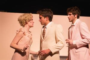Daisy Buchanan (Erin Powell) and Tom Buchanan (Dylan Hubbs) wrapped in a mix of emotions as Gatsby watches (Jason Friedman)