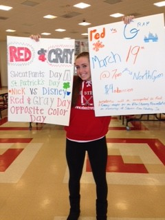 Senior Grey Team Captain Jamie Moore holds up posters for Red and Grey Night