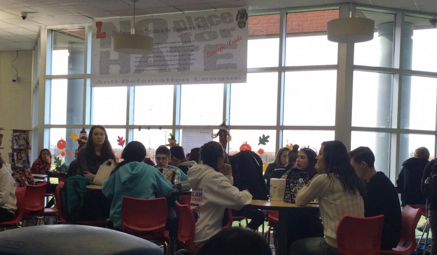Students eat lunch in the media center as one of of several venues available to them