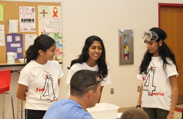 Megha Bharadwaj ('17), Jasmine Philip ('17), and Isabel Chacko ('17) explain the polymer diapers are made up of.