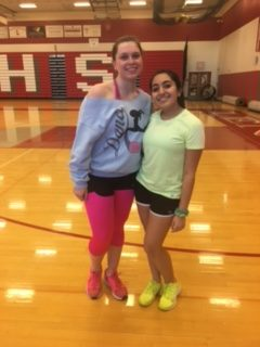 Amanda Smalfus and Sakshi Chopra, Class of 2018, pose for a picture in their 80's gear before the Zumba class begins.