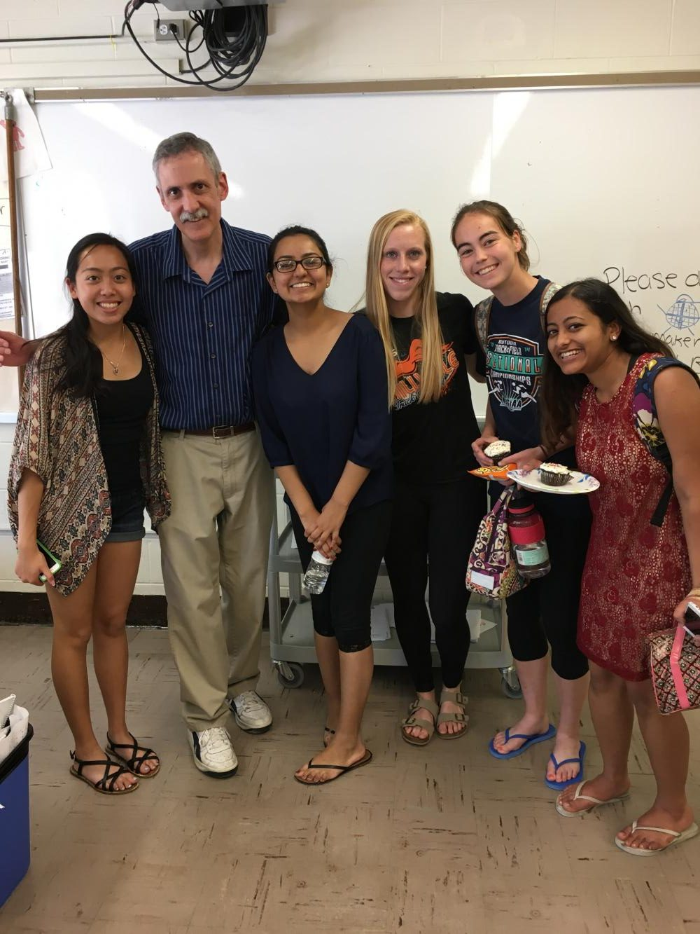 (Left to Right) Alexis Cao, Mr. Spitz, Srishti Dhar, Megan Quimby, Patricia Thomas, and Megha Bharadwaj