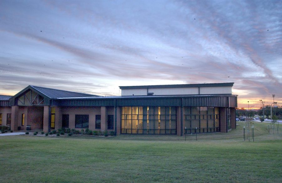 the-sun-rising-over-the-health-and-wellness-center-at-sheppard-afb-tx-on-oct-238571-1600